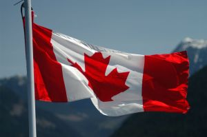 a Canada-Flag-and-Mountains_small